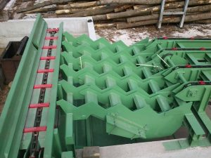 Xylo services MTEC Step feeder convoyage de chaîne à grumes